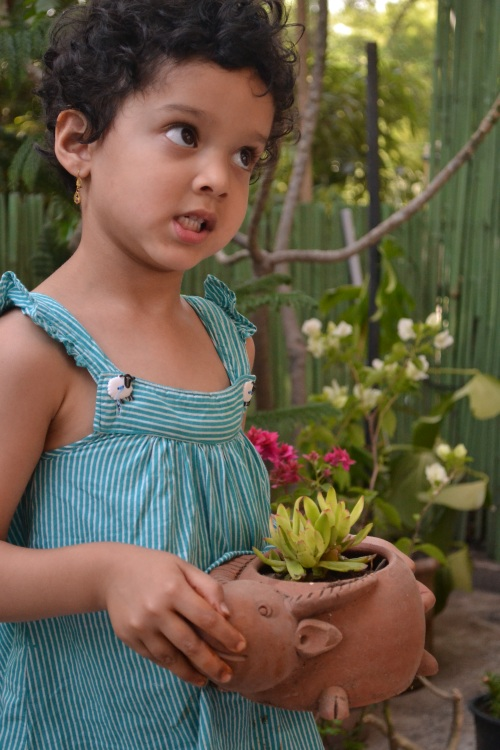 N with her plant